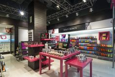 Sally Beauty store by Droguett AA Lima Peru - interesting display to the columns that doesn't interfere too much with sightlines into the store