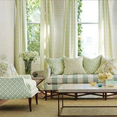 Gorgeous pattern mixing in greens and  blues with Kravet fabrics in living room