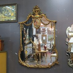 SOLD. Amazing vintage antique French style ornate carved gilt #mirror, circa 1920 stunning with oil painting in top center carved roses and sheaf's of wheat. Crown carved with basket of flowers and arrows $895!