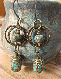 Love these! Antiqued brass chain and wire work blue porcelain beads featuring Tibetan barrel tube shape brass beads with inlaid turquoise. Wear them with a little dress or jeans,  handmade brass ear wires are coated to prevent sensitivity. These artisan earrings measure aprox. 3 inches in length. Rustic and earthy-chic. SOLD