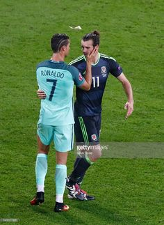 Gareth Bale of Wales embraces Cristiano Ronaldo of Portugal after the UEFA EURO 2016 semi final match between Portugal and Wales at Stade des Lumieres on July 6, 2016 in Lyon, France.