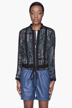 See By Chloe Black Multicolor Silk Jogging Jacket -  See By Chloe Black Multicolor Silk Jogging Jacket See By Chloe Long sleeve silk jacket in tones of blue. pink. and green. Tonal contrasting trim throughout. Stand collar. Two_way zip closure at front. Tonal decorative drawstring at elasticized hem. Lightly padded body. Fully lined. Tonal...