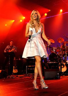 Carrie Underwood loves to keep it simple and that's exactly what she did with this off white dress as she performed. [Photo: Getty Images]
