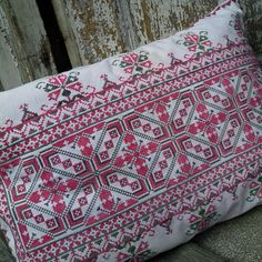 Cushion cover from vintage Transylvanian embroidery Originally red and black the stitching has faded to pink and grey with green tones Very pretty