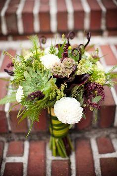 bridal bouquet of scabiosa pods, fern curls, succulents, etc
