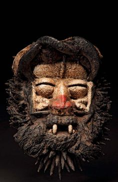 Africa | Mask from the Guere people of the Ivory Coast | Wood, pigment, resin and natural fiber