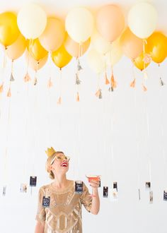 New Year's Eve party decor idea - balloon + photo decor idea {Courtesy of Oh Happy Day}