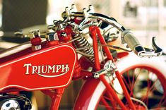 Vintage Red Triumph Motorcycle - Beautiful