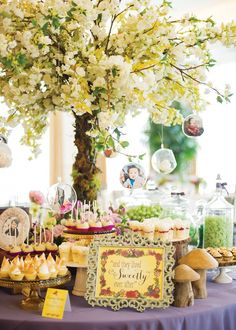 An enchanting Fairy Tale First Birthday (Dol Celebration) with whimsical floral arrangements and a rustic dessert table with adorable storybook cupcakes.