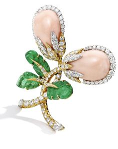 18 Karat Gold, Platinum, Coral, Diamond, and Emerald Brooch, David Webb Designed as intertwined flowers, set with two pear-shaped coral cabochons measuring approximately 22.0 by 15.0 mm, accented by round and pear-shaped diamonds weighing approximately 5.00 carats, completed by three carved emerald leaves, gross weight approximately 21 dwts, signed Webb.