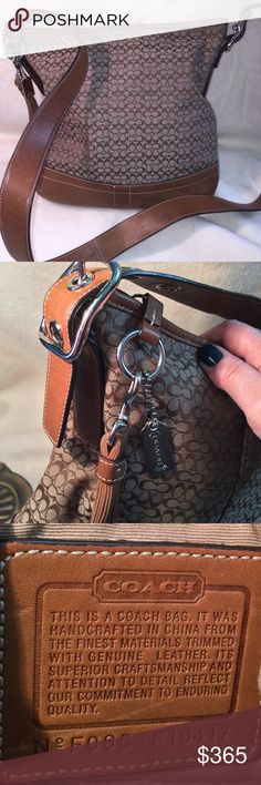 """Rare Coach Crossbody Small Signature Brown w/Adjus Rare Coach Crossbody Small Signature Brown high quality cloth with matching brown leather.  With Adjustable cross body strap (16 different lengths possible). Beautiful silver toned hardware. One coach silver key chain, one leather fringed accessory). Leather strap 21"""" x 1.25"""" wide. Bag 11"""" long, 10.75"""" wide, 2"""". Interior: clean, 1 6.5"""" zippered pocket, 2easy pockets, 1 D ring Pre-loved. Slight wear on outside bottom corners - see pic,This…"""