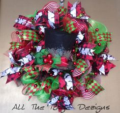 """From All the Rage Dezigns """"Christmas at the Haberdasher"""" wreath; RAZ black felt top hat amidst yards of red, green, black w/red stripe & red/white stripe mesh. Gorgeous black/red check 4"""" ribbon, diamond and mustache ribbon embellishments. $125. Check out this and other wreaths at http://www.etsy.com/shop/AllTheRageDezigns. RAZ Top Hat, all deco mesh and some ribbon purchased from http://www.trendytree.com. #trendytree #christmaswreath"""