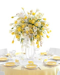 Yellow flowers for a summer affair might sound trite, but when they're in a dramatic centerpiece of phalaenopsis orchids, mimosa blossoms, and gold and white French tulips that arc and bend perfectly, the effect is wholly original. To make a real splash, pair with an ombre tablecloth and set with our watercolor-style place cards that require no artistic talent—just a printer.