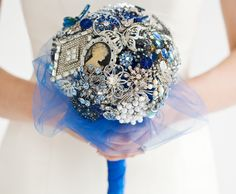 vintage brooch bouquet from Urbane Bouquet, NW Arkansas.  Blue stones, silver, rhinestones and pearls