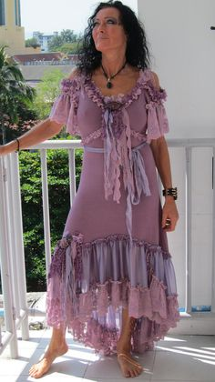 "boho dress, love the color and the ""cold shoulders"""