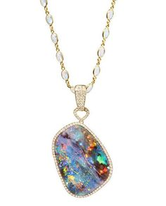 What a magnificent opal! 79.76ct Boulder Opal set in 18K Yellow Gold with Diamonds on a 22 inch Yellow Gold and Moonstone chain. #opal #jewelryaddict #jewelrydesigner #jewelrylover #jewelryporn #jewelryoftheday #jewelryjunkie #glamour #glamorous