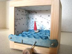 Kinetic Sculpture with Red Sailboat and  Nautical Charts. $38.00, via Etsy.