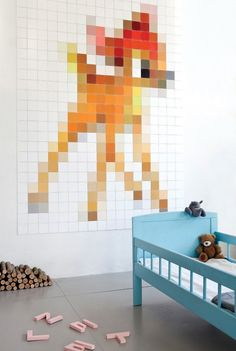 Great minimalistic kid's room. Let the kids play and decorate! Interesting pixelated bambi decoration too!
