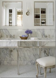 Notice how the walls are slabs, not tile and the sinks are marble!!