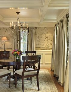 Lovely dining room. The wallpaper, the rug, the draperies all perfect. Love the ceiling and chandelier too.
