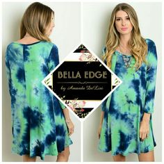 Navy mint tie-dye dress 95% RAYON, 5% SPANDEX. Made in the USA. This jersey knit dress features trendy tie-dye print in mint and navy, 3/4 sleeves, a rounded neckline, and a comfortable relaxed fit. Sizes small to large. Bella Edge Boutique  Dresses