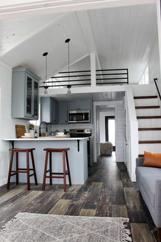 This is the Zion Park Model Tiny House by Mustard Seed Tiny Homes. It features a large covered porch that's built right into the unit. Inside, you've got a full-size main-floor bedroom,… homes The Zion Park Model Tiny House by Mustard Seed Tiny Homes Tiny House Loft, Best Tiny House, Modern Tiny House, Tiny House Living, Tiny House Plans, Small House Design, Tiny Loft, Interior Design Of House, Tiny House Ideas Kitchen