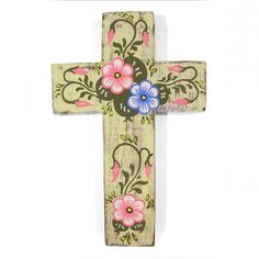 Rustic wooden cross decorated with a south american style painting.