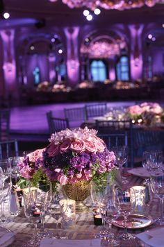 Detailed shot of the floral arrangements at guest dining tables