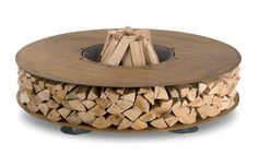 AK47 Zero - Outdoor Wood Fireplace - The Green Head - not sure about storage of wood so close to flames?