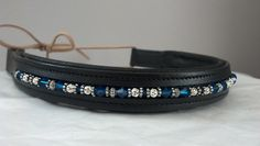 I make custom beaded browbands and also offer finished pieces for sale via my facebook page, http://www.facebook.com/nwbrowbands - Available in black...