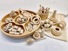 This play kit contain all of the sustainable wood toys and loose parts pictured. Majority if these items are sourced from northeastern USA. Each kit comes with a beautiful cotton muslin bag (tray not included). These kits are intended for ages Montessori Trays, Montessori Materials, Rainbow Playdough, Wooden Puzzles, Jigsaw Puzzles, Educational Toys For Kids, Toddler Toys, Baby Toys, Wood Toys