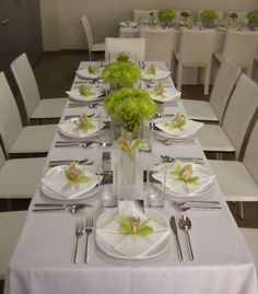 Square napkin fold in each place setting with the calla lily candy pouches on top.