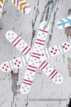Popsicle Stick Snowflake Ornaments By NotSoIdleHands.com Popsicle Stick Snowflake, Popsicle Stick Crafts For Kids, Snowflake Ornaments, Popsicle Sticks, Craft Stick Crafts, Snowflakes, Diy And Crafts, Christmas Ornaments, Craft Projects For Kids