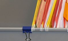 use a binder clip to prevent file folders from moving…genius!