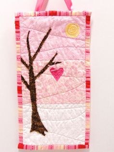 """wall art quilt- """"Woodland Valentine"""" in pink, brown and white."""