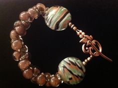 Candy Vonk uses Unicorne Beads brown teardrops and zebra stripe Coin Bead in her stunning bracelet. See more in her Etsy shop CandysJewelryBox, $30.00