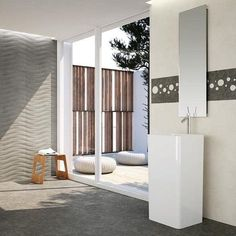 This is a rich, dark grey tile is in line with contemporary trends towards larger floor tiles.