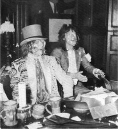 """Brian Jones & Mick Jagger after a custard pie fight at the Kensington Gore Hotel, where they held a """"Beggars Banquet"""" in celebration of the release of the Stones' new album of that name. (1968)"""