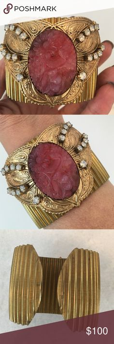 Wide Vintage Gold Tone Embellished Statement Cuff Carved oval pink oval stone is affixed on a butterfly shaped shield embellished with milky iridescent stones. Cuff is fluted and measures approximately 2 inches wide. Best suited for a small wrist. Vintage Jewelry Bracelets