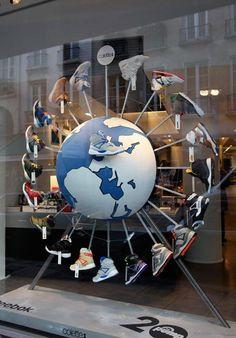 Around the world with Reebok shoe display. #retail #merchandising #window_display #shoes