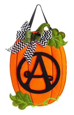 Autumn pumpkin themedmonogram door hanger for your fall or Thanksgiving outdoor or indoor décor. Constructed with a polyester blend material that looks and feels like real felt and accented with rich