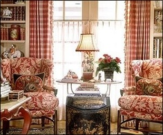 French country room - white bookshelves flank side windows, table in center, plump chairs on either side