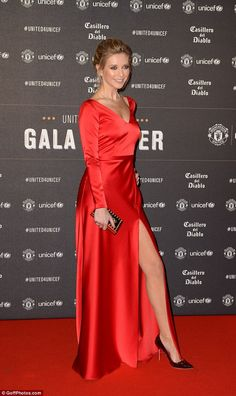 Red hot: The classy garment boasted long sleeves and a plunging neckline, and was set off ... Heels Outfits, Classy Outfits, Shoes Heels, Dress Shoes, Pumps, Red Silk Dress, Popular Dresses, Black High Heels, Classy Women