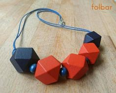 Chunky geometric wooden necklace in orange and navy £15.00