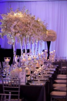 Contemporary Wedding Reception Ideas  white flowers in clear vases with candles