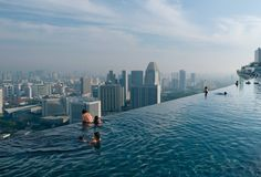 Infinity pool, 56th flloor at Marina Bay Sands, Singapore.  National Geographic via Powerfull Info (http://www.powerfullinfo.com/index.php?action=media;sa=item;in=142#).  In search of photo credit.