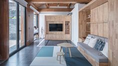 Chinese studio Dot Architects has completed a futuristic home in a traditional Beijing hutong, featuring moveable furniture modules and an extension construc. Decor Interior Design, Interior Design Living Room, Room Interior, Future House, Moving Walls, Inside A House, Futuristic Home, Living Room Furniture Layout, Smart Home
