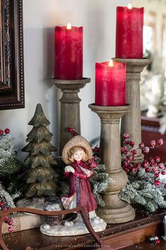 Trio of chunky faux bois candlesticks that balance out the height and scale of other holiday display.