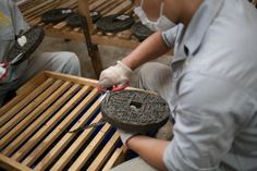 Forming pu'er cakes at a factory in Xishuangbanna, Yunnan