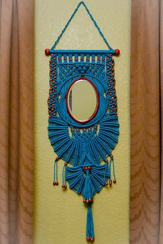Macrame wall hanger with mirror